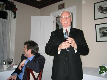 Don Vincent of RIA at a 2002 holiday party; Jeff Burnstein at left