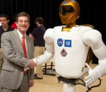 RIA President Jeff Burnstein shakes hands with GM-NASA Robonaut 2